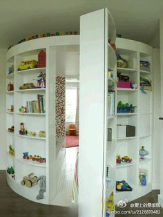 Playroom behind bookcase