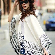 http://www.buyhathats.com/black-and-white-plaid-scarf-women-tassel-shawl-autumn-winter-wear.html