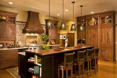 """18 feet long by approximately 14 feet deep. It is an interesting lay out as the stairs (in the far back corner of the kitchen) open up the space and add a separate entrance to the area.  15 months ago · Like      Witt Construction  The island is approximately 9' 6"""" long."""