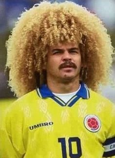 Carlos Valderrama's new pink hair Carlos Valderrama has curly pink hair; the man with the biggest blonde curly afro in Colombia and possibly in the world has decided to dye his hair pink. But, did Carlos Valderrama dye his hair…Read more → Carlos Valderrama, Football Hair, Football Soccer, Soccer Cup, Football Icon, Soccer Stars, Soccer League, Football Players, Bad Hair Day