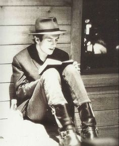 Joe Strummer reads and writes. Also has good taste in footwear and headwear, a notable double.