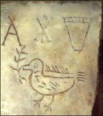 About 500 AD - BINCENTIA IN PACE, San Sebastiano Catacomb, Rome (Italy). Inscription (not shown in image) flanked by the Chi-Rho symbol, basket (indicating good works), and dove with olive branch (from Genesis 8:11).
