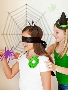 Halloween Carnival Booth Ideas | Pin the Spider on the Web Halloween Party Game - on HGTV