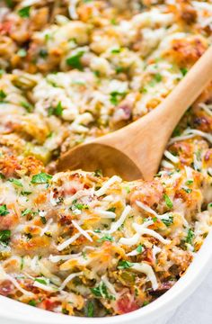 Healthy Spaghetti Squash Casserole with ground turkey, tomatoes and Italian spices. Easy, CHEESY, and a crowd pleaser. Low carb, freezer friendly recipe!