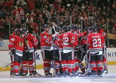 CHICAGO, IL - JANUARY 19: Members of the Chicago Blackhawks celebrate as Sheldon Brookbank #17 talks to Patrick Kane #88 (L) who scored the game-winning goal in a shootout against the Boston Bruins at the United Center on January 19, 2014 in Chicago, Illinois. The Blackhawks defeated the Bruins 3-2 in a shootout. (Photo by Jonathan Daniel/Getty Images)