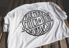 Ride More Work Less Badge Tee from Scotch and Iron. Scotch and Iron is a Motorcycle and Automotive Inspired clothing brand featuring mens and womens clothing.  #ridemoreworkless