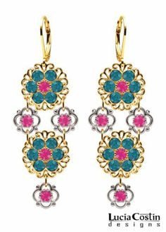 Classy Dangle Flower Earrings Amazingly Designed by Lucia Costin with Filigree Details and, Enhanced with .925 Sterling Silver 4 Petal Flowers, Dark Turquoise and Fuchsia Swarovski Crystals ; 14K Yellow Gold over .925 Sterling Silver; Handmade in USA Lucia Costin. $90.00. Floral design accompanied by cute details. Update your everyday style with inspiration when wearing this piece of jewelry. Unique jewelry handmade in USA. Lucia Costin flower shaped drop earrings. Amazin...