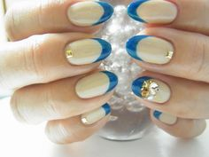 Pearl white Nails with light Blue French Tip on Stiletto Rounded Nails free hand nail art