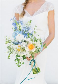 blue orange and white wedding bouquet #bouquet #bride #weddingchicks http://www.weddingchicks.com/2014/01/30/jekyll-island/