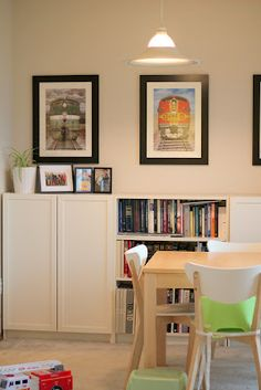 Ikea billy bookcases as dining room/book storage. Such a clean, modern look.