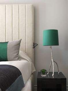 Clever reading lamp is built into headboard. This luxurious Swiss chalet has been completely redesigned by the renowned interior designer Kelly Hoppen