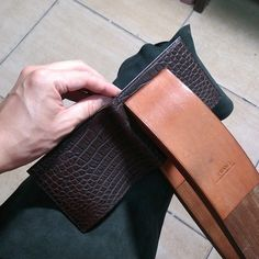 shiang-lifetime-leathercraft:  In the making of full #crocodileskin wallet. Stitch up the main frame. Edge finish to go and it's done.  #Shiang #Taiwan #middleeast #Dubai #menswear #mensfashion #gentleman #dapper #gift #color #brown #love #beautiful #gorgeous #alligatorskin #gift #Christmas #Christmasgift #style #classic #musthave #madetoorder #MTO #handstitch #luxury #lifestyle #crocbags #purse