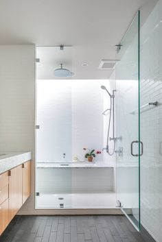 Fantastic Bathtub Shower Combo for Your Bathroom Decor Ideas: White Subway Tile Bathroom With Rain Shower Head And Bathtub Shower Combo Plus Glass Shoer Door And Floating Vanity Cabinet