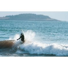 Nick Power going vert - surfing - surf maine - surf new england - cold water surfing