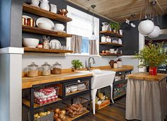 """""""There's too much opportunity for messy shelves — instead, keep a good proportion of closed doors so you can hide the chaos,"""" Weitzman says. If you're stuck with open shelves, cull your collection (do you really need all those souvenir mugs?) and hide clutter in prettier storage bins.   - CountryLiving.com"""