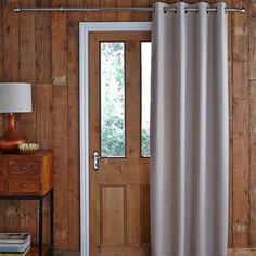 Featuring an eyelet header, this natural-coloured door curtain is fully thermal lined for effective draught reduction and is available in a choice of sizes....