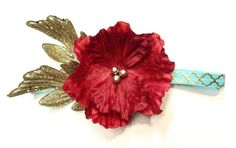 This gorgeous teal, red and gold boho chic headband is the perfect accessory to be sure you stand out! Headband features red silk flower, gold