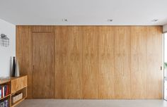 When you live in a small space, flexibility is key. In this 700 square meters apartment located in Sao Paulo, the architects made the most of the available extension with a folding wood panel that …