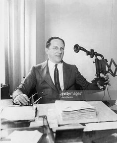 American professional gambler Arnold Rothstein (1883 - 1928) sits at his desk and pulls the telephone from the wall, 1910s. Rothstein was accused of masterminding the Black Sox baseball scandal of 1919, in which eight teammembers of the Chicago White Sox confessed to accepting bribes to throw the World Series to the Cincinnati Reds.