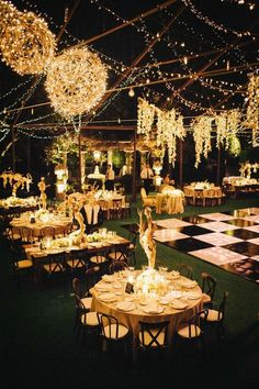An outdoor black tie wedding ceremony with gorgeous golden lights and tablescapes