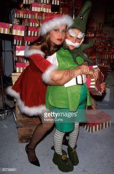 Photo d'actualité : Model Laetitia Casta and child costumed as elf...