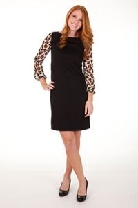 Nadine Dress features a black bodice with chiffon sleeves in a cheetah print. By Tracy Negoshian.