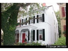 266 King George Street, Annapolis, MD 21401 — Outstanding period home crafted around 1910 featuring authentic period detailing. Painstakingly renovated and modernized to offer every convenience of modern living. Beautiful mouldings, ten foot ceilings, original heart of pine floors, custom built-ins, cherry cabinets, granite counters, stainless steel appliances.  A second and third floor master bedroom. Brick courtyard and large rear garden.