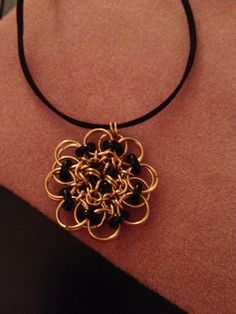 Black and gold chainmaille pendant