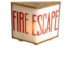 Vintage late 1940s fire escape sign with very cool triangular shaped glass lens…