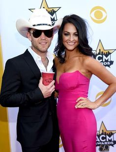 Recording artist Justin Moore and Kate Moore attend the 50th Academy Of Country Music Awards at AT&T Stadium on April 19, 2015 in Arlington, Texas.