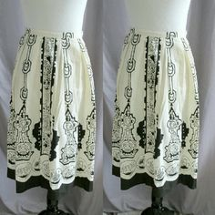 """""""Azteca"""" Full Skirt Sturdy off white colored cotton skirt with a black design. There are silver sequins added to give this skirt the tiniest bit of extra. Even with the sequins this skirt is still work appropriate. Has a side zip and button closure.  DD 31.03.16 younique Skirts A-Line or Full"""