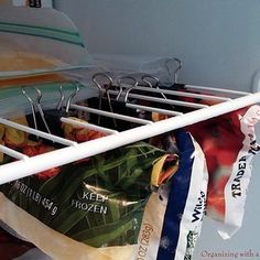 If you keep lots of frozen fruits and veggies around, use binder clips to fake a second shelf in your freezer. | 7 Easy Organizing Tricks You'll Actually Want To Try