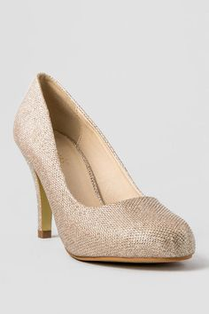 "Add some sparkle to your holiday look!  The Just 1 Champagne Glitter Pumps are made up of a shimmery champagne textured material that shines with every step you take & a thin heel that adds a touch of elegance.  Wear these with your party dress and gold accessories for a complete look!<br /> <br /> - 3.5"" heel<br /> - All man made materials<br /> - Measurements were taken using size 7M and may vary by size<br /> - Our recommendation: runs a half size small<br /> - Imported"