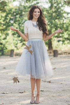 Every girl needs a tulle skirt in her closet, especially when it's one as pretty as this! The midi length and soft color makes it the perfect feminine and fun piece! Self: 100% Polyester. Model is wea