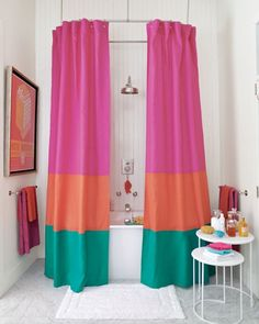 Keep things simple with white walls + a bright colorful shower curtain.