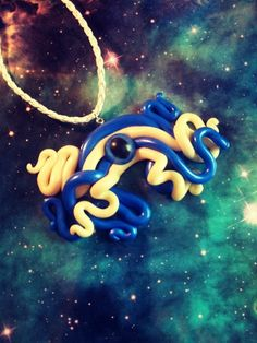 Glow in the dark blue octopus tentacle pendant by LillyMooncat, $20.00 http://www.etsy.com/listing/120511963/glow-in-the-dark-blue-octopus-tentacle
