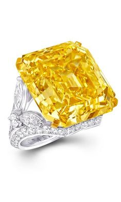 Graff ring featuring one emerald-cut 52.73ct Fancy Vivid Yellow diamond and further white diamonds. #YellowDiamonds