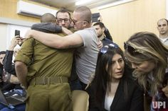 Israeli soldier Elor Azaria is embraced by family and friends at the start of his sentencing hearing in a Israel military court in Tel…