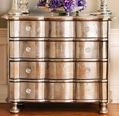 Paint an old dresser with metallic paint to give it an edgy, glamorous look