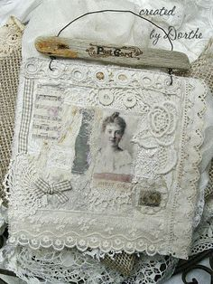 a lace and stitching delight - love that it is hanging off the driftwood and wire