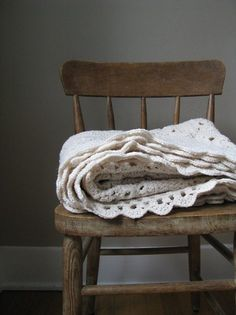 Grey wall, blanket, stripped chair