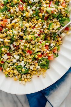 This delicious corn salad recipe features raw sweet corn, fresh herbs, radish and more. It's the perfect summertime salad! #cornsalad