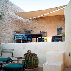 lovely split level Terrace protected from the sun with shade sails