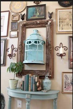 I love this idea for a display of flowers or objets d'art: a half birdcage mounted on the wall, surrounded by a vintage frame. Sort of a combination eclectic, bohemian, shabby cottage chic vibe. -I have a half bird cage and an empty frame. Boho Deco, Deco Boheme, Boho Chic, Eclectic Gallery Wall, Eclectic Wall Decor, Diy Casa, Bird Cages, Bird Nests, Home And Deco