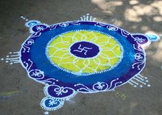 https://flic.kr/p/uYhMJ | G'pule - Rangoli at Keshavsoot's home | Rangoli - design done using colour powder's, birthplace of the famous Marathi poet, Keshavsoot. It is a small peaceful village about 1 km. away from Ganapatipule. The poet's house was recently renovated and converted into a students' hostel. The Marathi Sahitya Parishad (Marathi Literature Society) has constructed a beautiful monument called Keshavsoot Smarak in memory of him.