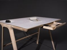 Maya desk by Sean Dare. Lovely craftsmanship and the back rail for putting your feet up is huge if you spend lots of time at your desk.