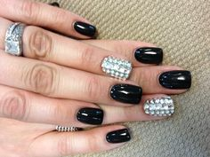 Gel nail design, I like the idea of black & 1 silver not the rinestones