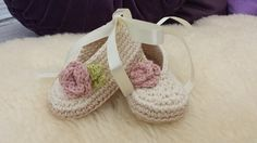 Crocheted baby ballerina with lovely vintage rose detail.