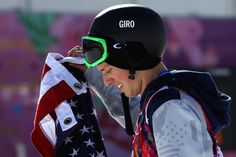 Gold medalist Joss Christensen of the United States holds the Stars and Stripes flag after the Freestyle Skiing Men's Ski Slopestyle Finals (c) Getty Images