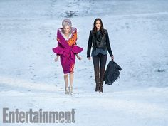 XASGTRFCDSVFHGBUKABJGSGB!!!!!!! I'm freaking out right now with the new stills...holy shit...Effie looks like a present. Which this pic is. To us. Omg. Again with some apparent Asian influence... It looks as if they're trekking badassly across a desert, but that's gotta be snow. 'The Hunger Games: Mockingjay - Part 2': 8 EW exclusive photos   Elizabeth Banks and Jennifer Lawrence   EW.com